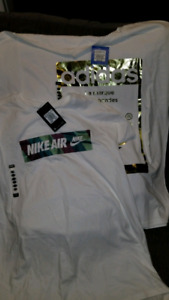 T-shirts .1 adidas.1nike air price tags still attached.