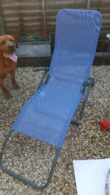 2x blue lounger deck chairs garden