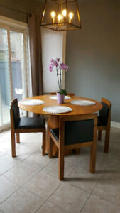 Round breakfast nook table with 4 chairs