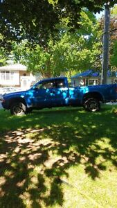 blue 2000 Dodge Dakota Pickup Truck