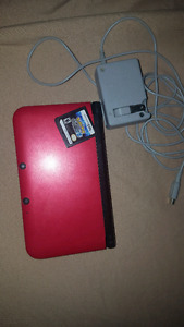 Red Nintendo 3ds xl with Pokemon