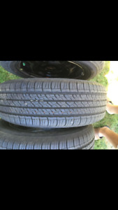 15 inch Firestone all season tires with steel rims