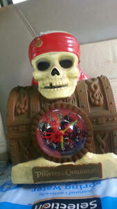 ► Disney's Pirates of the Caribbean Clock and Coin Bank