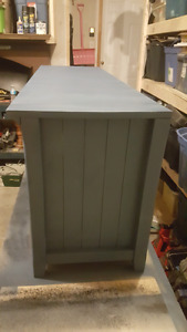 Fresh chalk painted entertainment unit with clear coat $80.00
