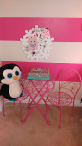Small pink metal table and chairs for kids.
