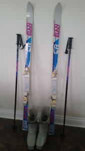 Downhill skis, boots, poles