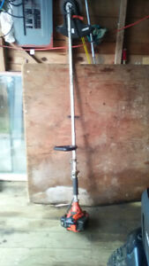 ECHO BRUSH CUTTER, JUST OVERHAULED BY GATES, WORKS WELL,