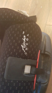 Alpha Omega black car seat with extra cover