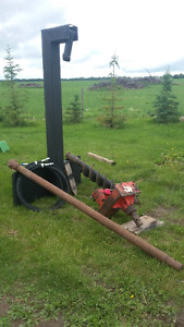 Auger with skidsteer boom and attachments