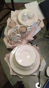 White stoneware dishes with silver trim