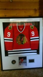 Framed, signed Bobby Hull jersey with authentication.
