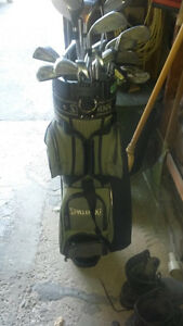 Assorted used golf clubs and bag