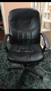 Black office rolling armchair
