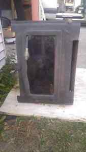 Wood stove insert with blower