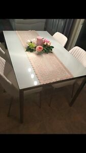 IKEA dining table, chrome plated, high gloss white glass top.