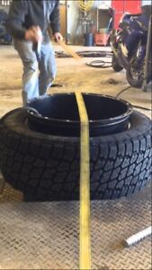 Looking for someone to stretch 12.5 tire on 20x14 wheel.