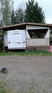 Trailer for sale with 10'x24' deck at lot 51 Dog Lake Resort