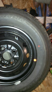 Tire for sale P175/70 R13 on a rim$50.00