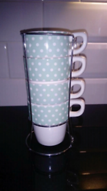 Four lovely small cups in stand from Avon