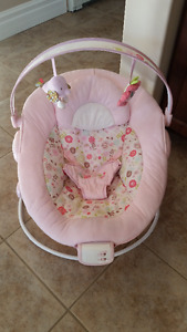 Pink bouncy chair (vibrates and plays music)