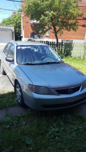 Mazda protegé 2L 850$ negotiable 2002