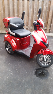 Electric 48 Volt, 3 wheeled scooter, brand new condition.