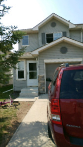 Townhouse with finished basement & central A/C for rent