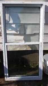for sale a gas lawnmore 20.00 a newer window 29x57 25.00