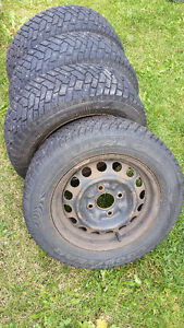 4 x Goodyear Ultra Grip Winter Tires with 4 lug Rims
