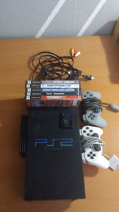 PS2 with games, controlers and a memory card