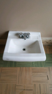 Bathroom sink with taps