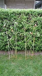 "Pair of 4'-6"" high rustic metal garden ornaments"
