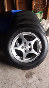 205/65/15 TIRES ON ALUMINUM RIMS