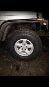 31x10.50R15 tires and Jeep wheels