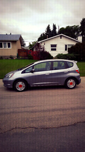 2009 Honda - fit (open to trades and negotiable)