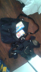 Diaper bag with things inside  and carrier
