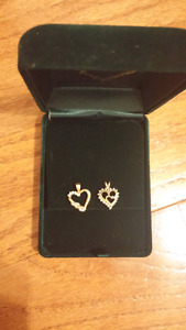 Set of two real gold diamond heart pendents