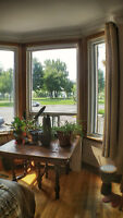 Fully furnished- 4 bedroom one year lease on the river in Verdun