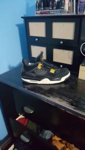 Used Air Jordan 4 retro black and gold 9.5