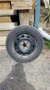 Set of four snow tires with rims