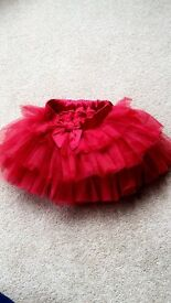 2 frilly skirts aged 18-24 months