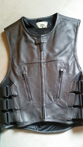 Like New ICON leather motorcycle vest S/M with back protector