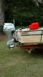 9.9 Honda 4-stroke outboard with boat and trailer