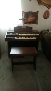 Vintage piano organ combo with bench and light