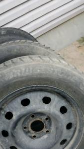 225 65 17  Dodge Caravan winter tire and rim