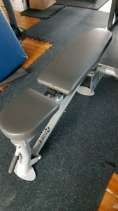 Hoist adjustable weight bench flat to incline.