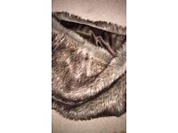 Fur snood, brand new. Never been worn. Brought for £20.