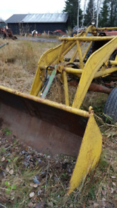 Farm tractor loader with bucket