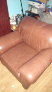 Brown leather matching chair and love seat