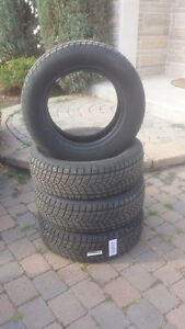 4 winter tires to sell # 4 pneus d hiver a vendre- P233-63R17 West Island Greater Montréal image 1
